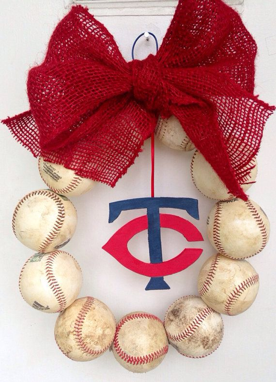 Minnesota Twins Baseball Wreath via Etsy. This is what you guys are making me for mothers day. I don't want new shiny balls I want old balls & orange & black bow & a harlem thingy hanging in the middle. if this doesn't tell you how to make you can google it ive seen videos how to make it