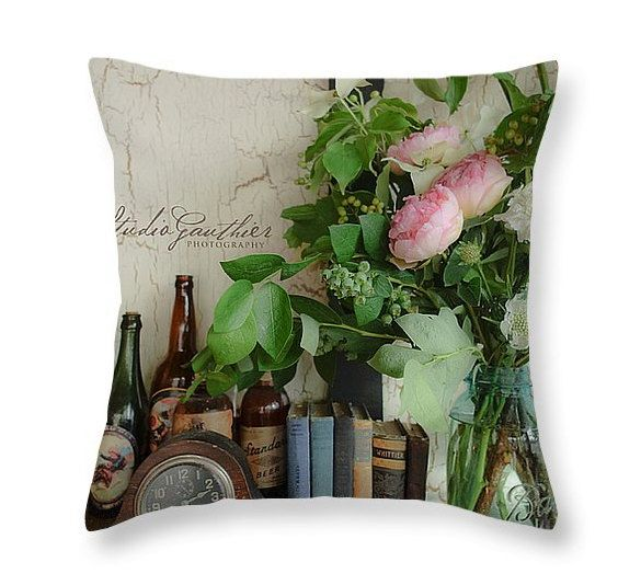 Book nerds love Powell's City of Books and this pink floral throw pillow with Antique books © StudioGauthier