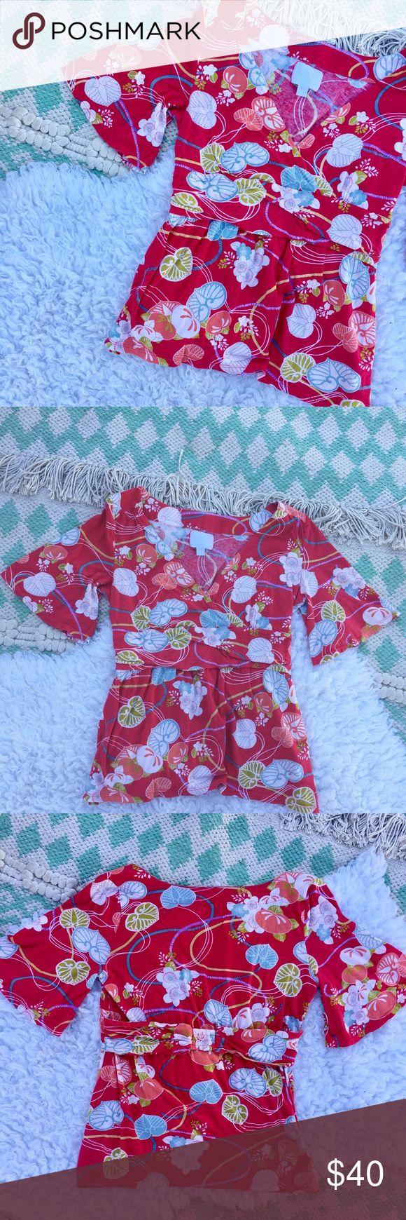 Anthropologie Deletta Wrap Flutter Sleeve Top Red floral faux wrap top with flutter sleeves. stretch band around back. 💫 Smoke free home. Offers are welcome! No trades, please. Bundle multiple items for a discount and only pay for shipping once! Anthropologie Tops