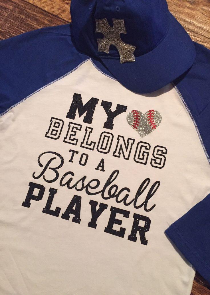 Baseball Alley Designs - My Heart Belongs to A Ballplayer Mom/Girlfriend Baseball Tee, $24.00 (http://baseballalley.net/my-heart-belongs-to-a-ballplayer-mom-girlfriend-baseball-tee/)