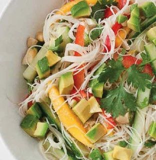 The tangy coconut lime dressing in this cool and colorful Thai rice noodle salad goes hand in hand with naturally sweet mango and red bell pepper.
