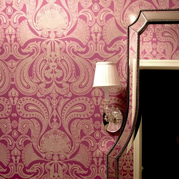 This beautiful powder room features purple damask