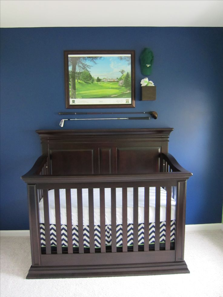 Baby B's nursery complete with golf clubs, baby golf shoes, hat and picture of the course his daddy grew up caddying at.