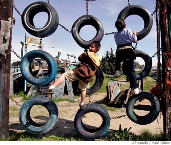 Angel Hernandez (left) and Sierra Thomas, both from Richmond, climb on old tires at Adventure Playground in Berkeley, Calif. on Saturday, March 10, 2007. Adventure Playground is a unique location where children can play on structures that they actually create and construct using tools provided to them. The playground�s been around since 1979 but the concept began after WW II in Europe. At the Berkeley park, countless pieces of scrap wood, tires, rope and other material is donated and used…