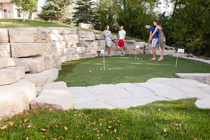 The impressive Outcropping walls create a backdrop for this patio mini golf course.