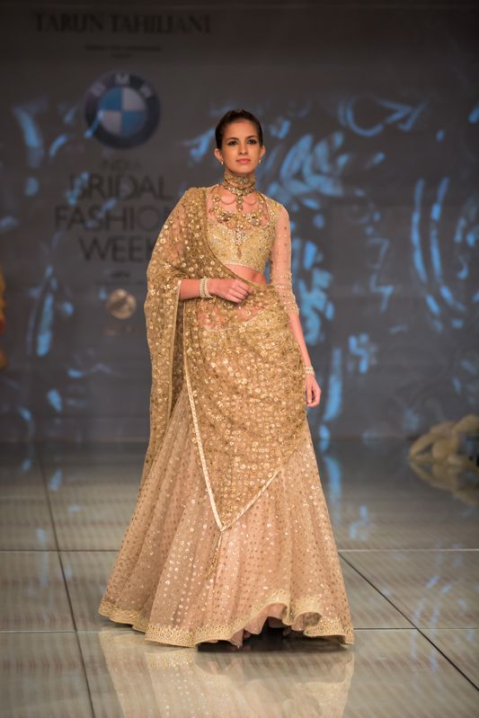Tarun Tahiliani gold sequin Indian bridal lehnga. More here: http://www.indianweddingsite.com/bmw-india-bridal-fashion-week-ibfw-2014-tarun-tahiliani-show/