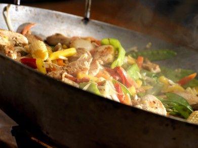 op smaak brengen wok