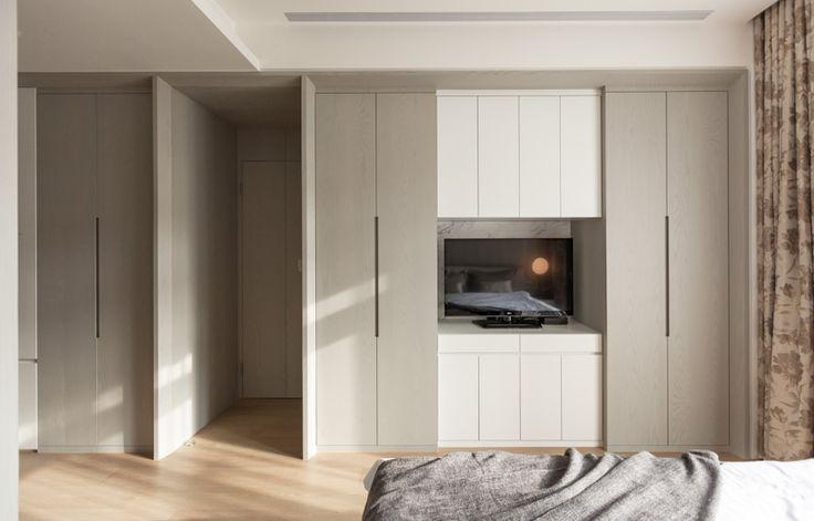 Hinged door wardrobe with TV space.