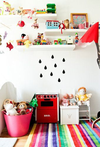 Love the bright, happy colours and raindrops wall sticker. From Red House