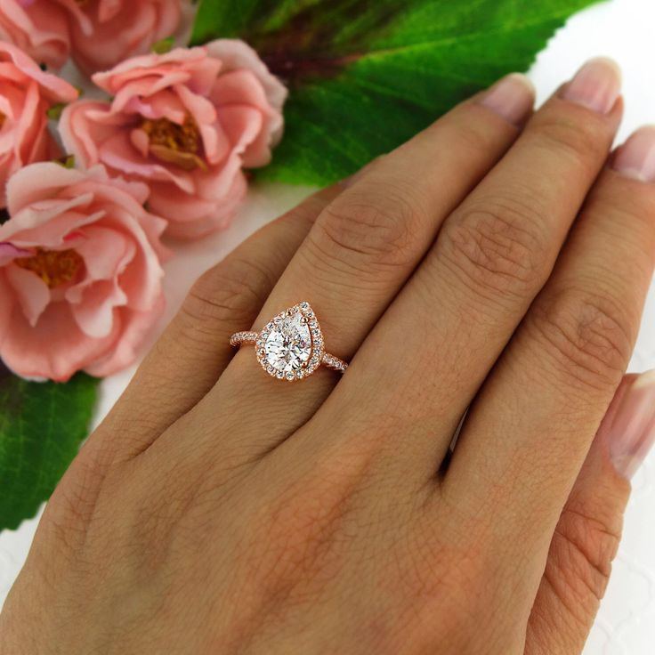 1.5 ctw Classic Pear Engagement Ring, Man Made Diamond Simulants, Halo Wedding Ring, Promise Ring, Sterling Silver, Rose Gold Plated by TigerGemstones on Etsy https://www.etsy.com/listing/239741548/15-ctw-classic-pear-engagement-ring-man