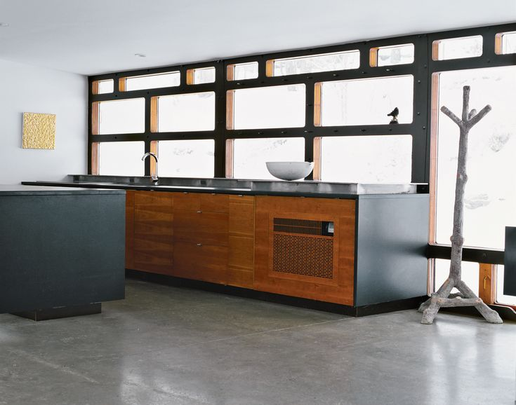 """Wooten anchored the kitchen with a faux-bois coatrack from France. """"Since Greg's…"""