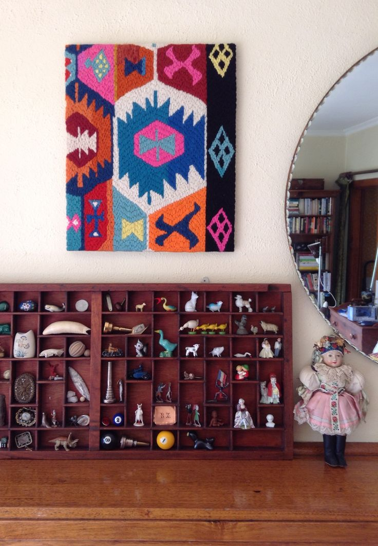 Printers tray with treasures and one of my tapestries based on a fragment of antique kilim. And a vintage Czech dolly.