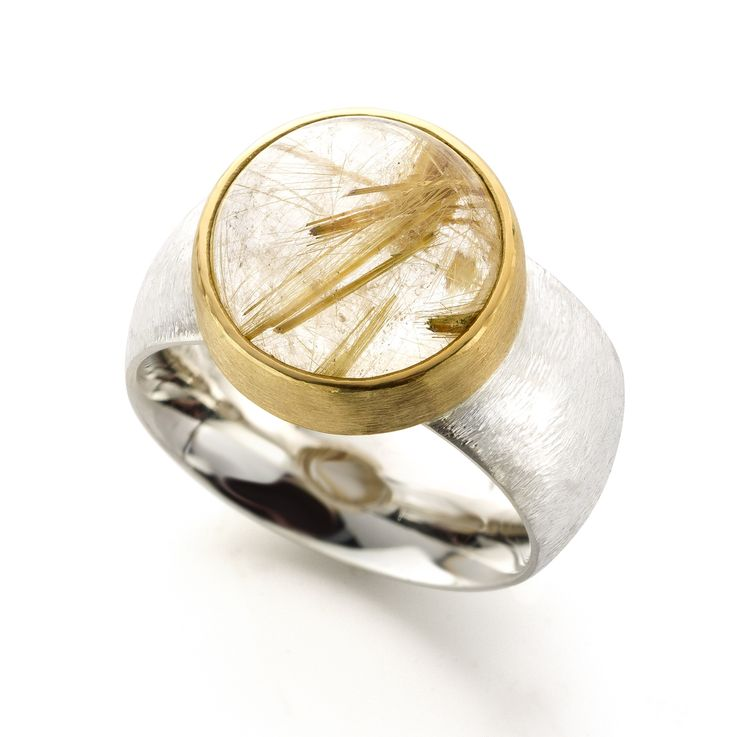 Silver and 22 karat gold ring with rutilated quartz. www.hoogenboombogers.com