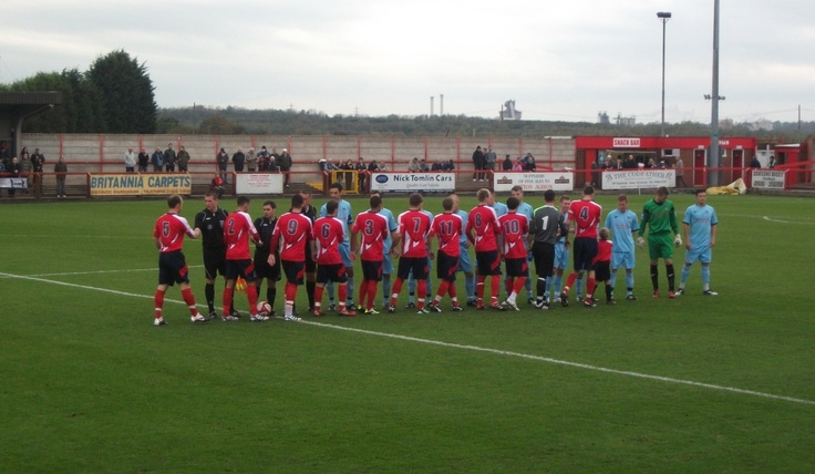 Witton Albion and Barrow players shake hands before their FA Cup 4th Qualifying Round match (Wincham Park 2011)