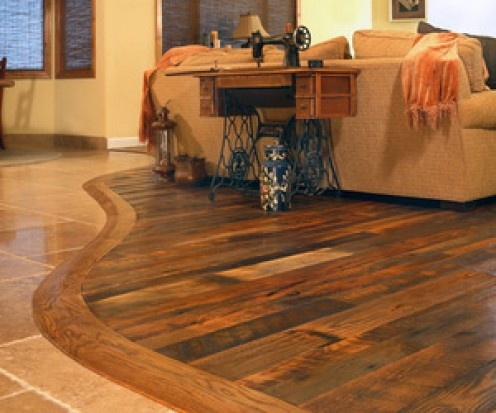 Barnwood flooring paired with tile, interesting idea rather than a straight line edge