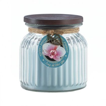 <p>Create a spa-like ambiance in any room with this relaxing and rejuvenating jar candle. Warm floral notes and fresh scent will envelop your room from this ribbed jar candle with lid. 16 oz and 100 burn time. </p>