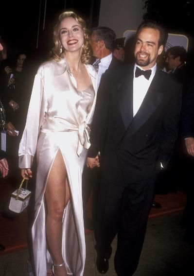 1995 Flashback: See Who Walked the Golden Globes Carpet 20 Years Ago | Sharon Stone.Sharon Stone     Years before Angelina Jolie's right leg became the star of the red carpet, Sharon Stone showed off a shapely thigh in her Golden Globes gown. Stone presented the award for Best Actor and Actress in a Motion Picture, Drama.