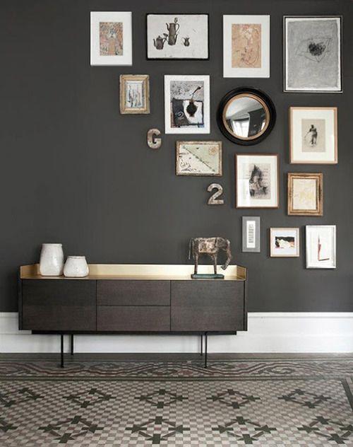 Art collage on dark walls