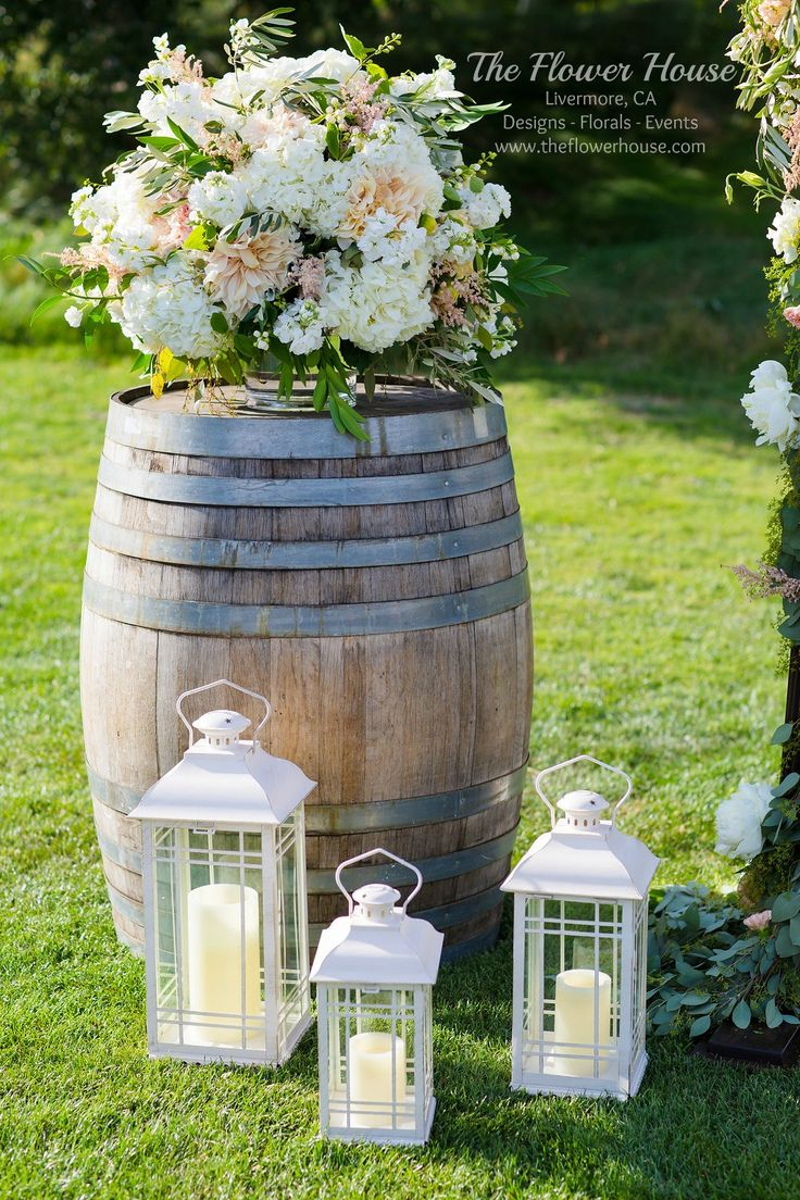 Wedding ceremony alter floral pieces placed on wine