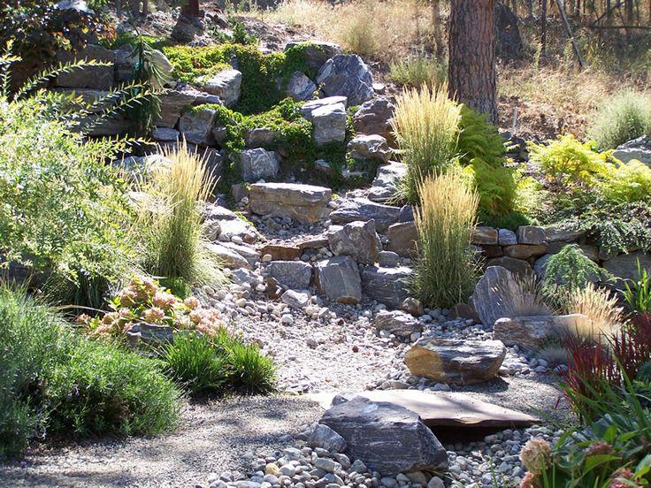 Dry creek bed landscaping designs synergy landscape for Garden getaway designs