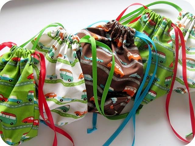 http://homemadebyjill.blogspot.com/2010/10/car-party-favor-bags.html