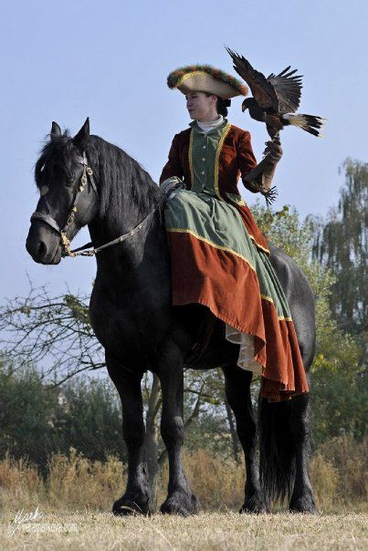 side saddle, love to try this some time. Especially with a big black horse and a beautiful bird :)