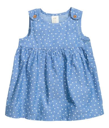 Dress in airy cotton fabric with printed dots. Buttons at shoulders and snap fastener at one side. Lined at top.