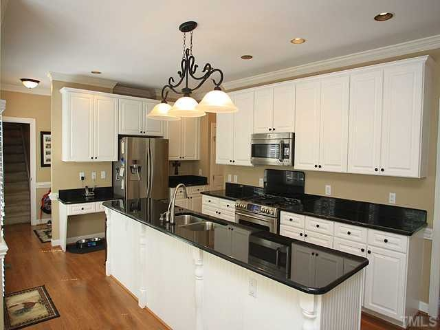 Gorgeous kitchen nice combination of black granite for Kitchen countertops and cabinet combinations