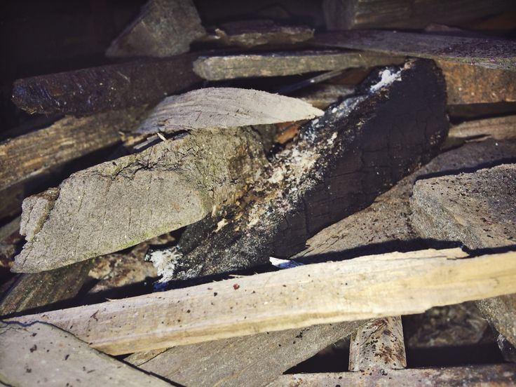 This is a photo of some firewood inside a chiminea to represent the texture 'rough'.