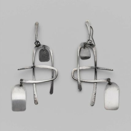 "Art Smith (1917-1982). One of the leading modernist jewelers of the mid-twentieth century, Smith trained at Cooper Union. Inspired by surrealism, biomorphicism, and primitivism, Art Smith's jewelry is dynamic in its size and form. Although sometimes massive in scale, his jewelry remains lightweight and wearable. See ""From the Village to Vogue: The Modernist Jewelry of Art Smith""."