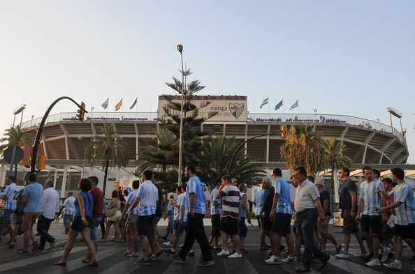 Malaga CF supporters make their way to La Rosaleda Stadium for the La Liga match between Malaga CF and FC Barcelona at La Rosaleda Stadium on August 25, 2013 in Malaga, Spain.