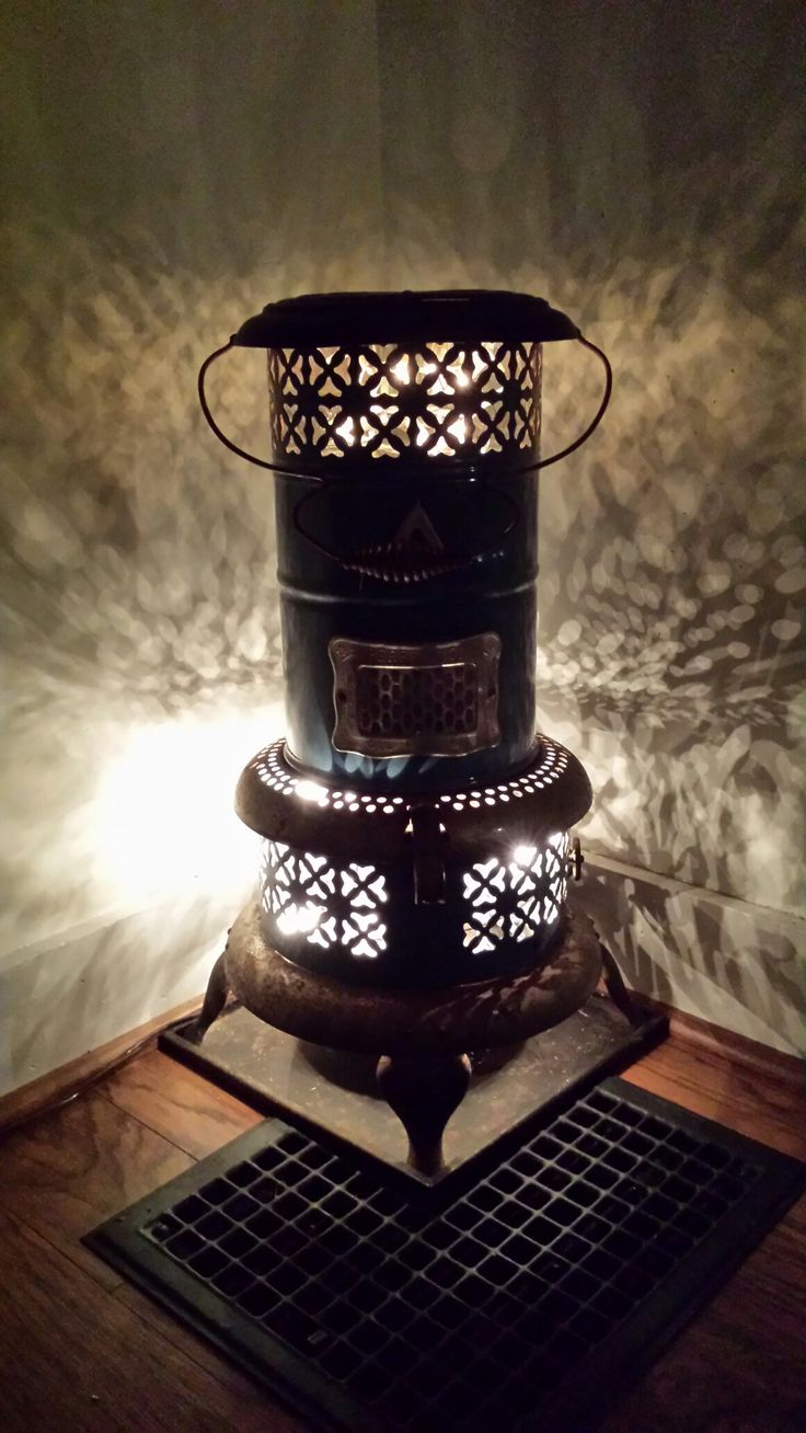 Antique kerosene heater with lights added for vintage decor