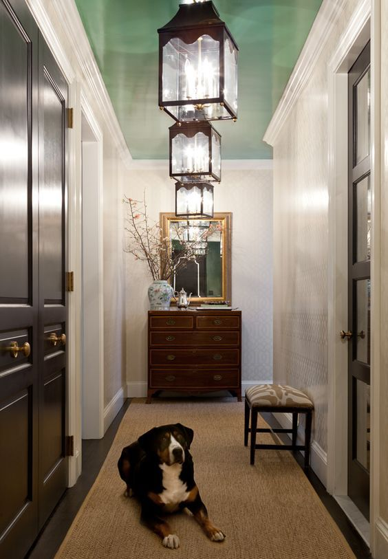 """Love the surprise pop of color on the ceiling in this hallway.   """"I AM ALWAYS slightly suspicious of people who don't like dogs in the house,"""" said the New York City-b..."""