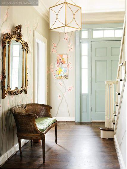 mint green door; gilt accents; cherry blossom wallpaper