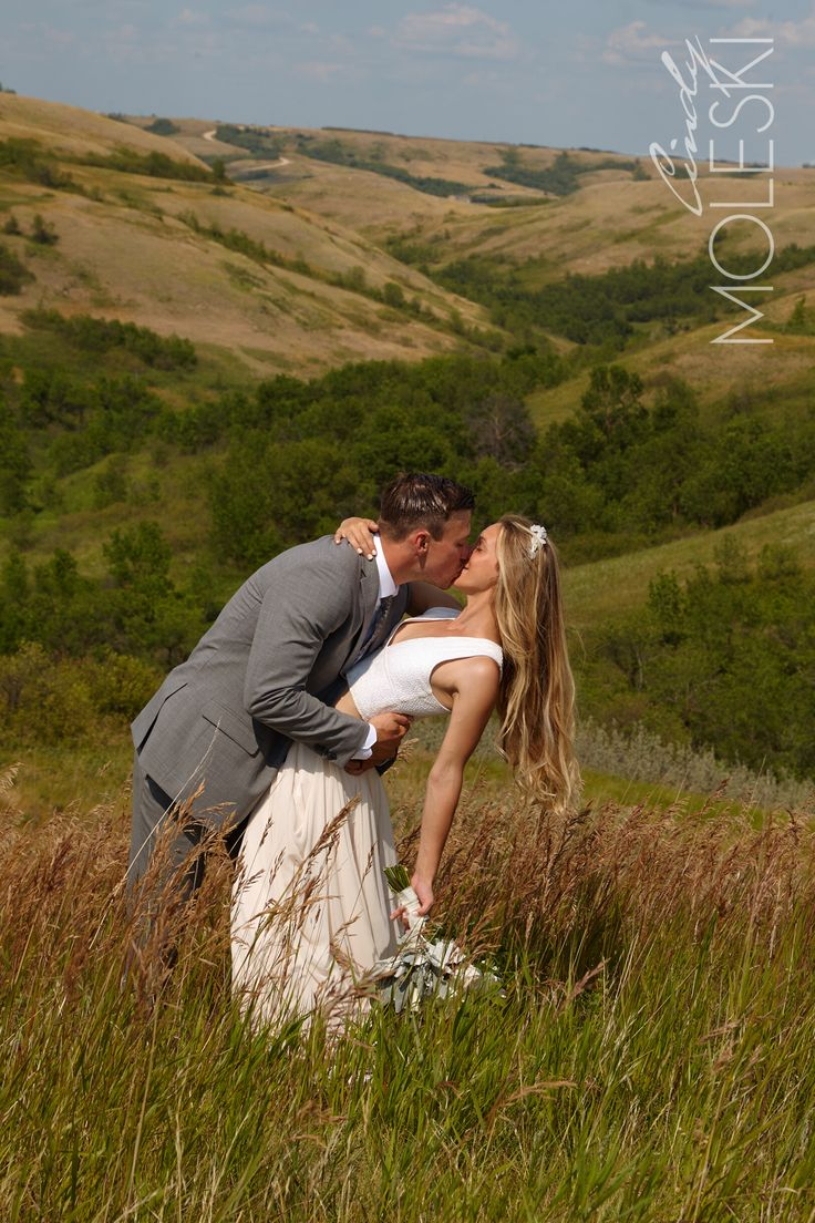 A stunning location,  a custom gown, a beautiful couple.