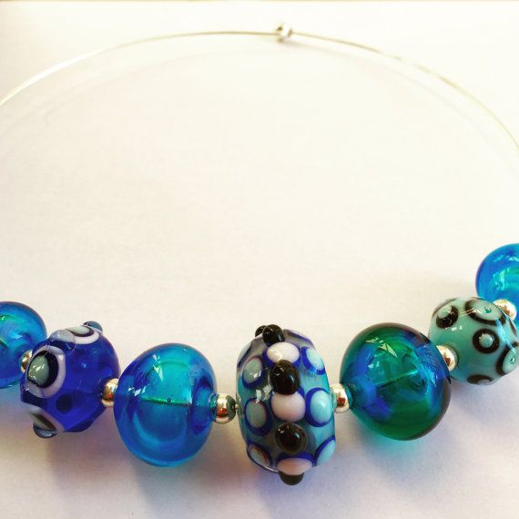 Necklace with handmade lampwork beads by Magrada on Etsy