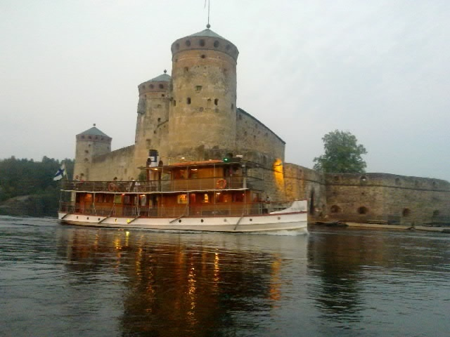 The medieval castle in Savonlinna, Finland. A steam boat just happened to pass by..
