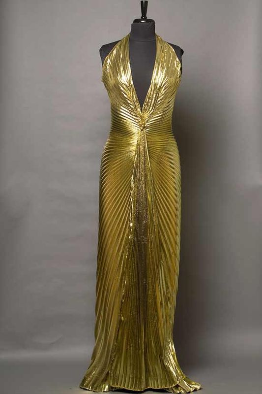 """William Travilla gold lamé gown worn by Marilyn Monroe in the movie """"Gentlemen Prefer Blondes"""" is now an icon in itself."""