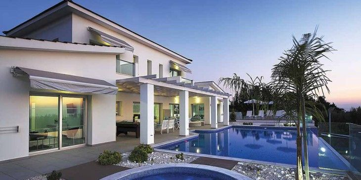 This grand and luxurious Cypriot villa looks out on to the incredibly beautiful countryside and offers guest a delightful stay with it's many perks, from: the high end private gym to the outdoor tennis and squash courts.