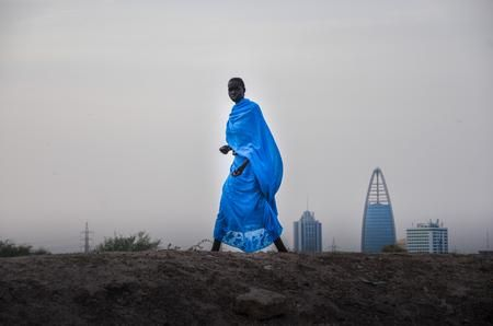 The women in blue dress Photo by Diana Iskander — National Geographic Your Shot