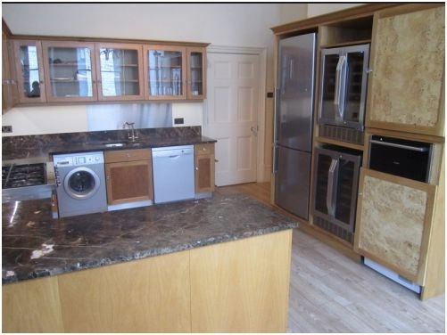 A used, solid bird\'s eye maple 8 year old kitchen.     The kitchen features luxury granite worktops and top of the range appliances. It also features superb storage options including two magic corner cupboards and a standalone dresser. £4950