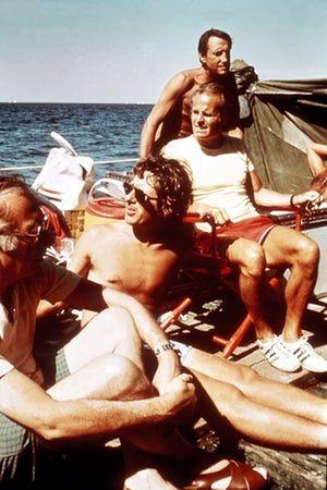 Director Steven Spielberg [centre] producer Richard Zanuck [red shorts] and actor Roy Scheider Jaws film