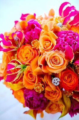 Get Inspired: Bright and colorful pink and orange blooms make a striking bridal bouquet. #OrangeWednesday @neatcompany