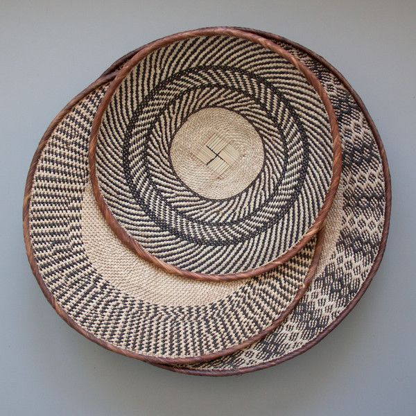 Tonga Basket | The Woven Trail.  Made by the Batonga people in northern Zimbabwe.  Each pattern is intricately crafted to create unique art.  Beautiful hung on a wall or as a display piece on a coffee table.  #handmade #artisan