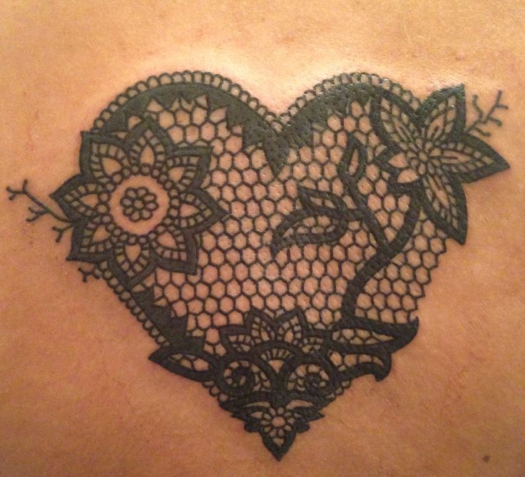 I've said it before and I'll say it again...I love lace tattoos ;) very feminine. Probably my favorite lace heart tattoo I've seen