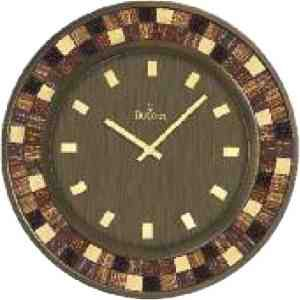 "Mosaica clock with metal case, burnished bronze finish. Raised mosaic hour markers. Individual mosaic glass inserts in case. Protective glass lens. Dia.: 18.75"" D: 2""."