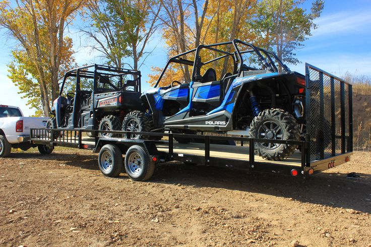 Echo 26' Advantage ATV-UTV side by side trailer with two full size machines. Shown with optional pull out side loading ramps.
