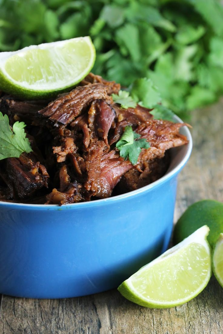Easy Slow Cooker Chili-Lime Mexican Shredded Beef from The Stay At Home Chef. Only 6 ingredients for an easy, tasty shredded beef made in the crockpot!