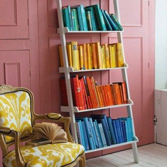 Arrange books in a colour-coded pattern, starting with the lightest at the top and working your way down for a graduated effect. This works well on all styles of bookcase from individual ladders to a continuous rainbow on a run of wall-mounted shelving.