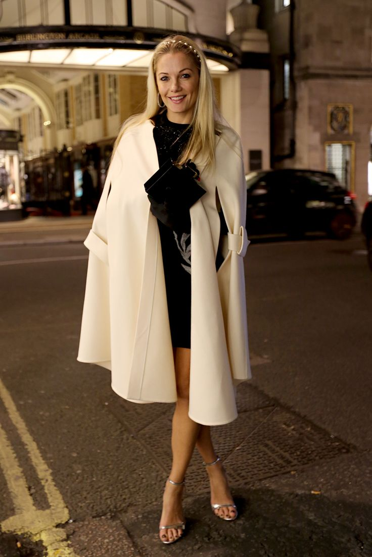 Caroline Fleming Dress: Alexander McQueen Bag: Anja Hindmarch Shoes: Gianvito Rossi Cape: Celine Jewelry: Chanel (hairband) Gloves: Birger Christensen